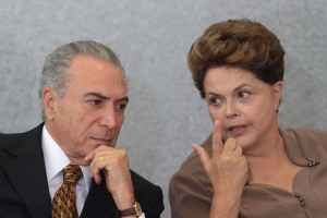 Brazil's President Dilma Rousseff, right, talks with her Vice President Michel Temer during a ceremony at Planalto Palace in Brasilia, Brazil, Tuesday, April 24, 2012. Activists are warning that a proposed revamp of Brazil's tough environmental law could roll back historic gains in the fight against Amazon deforestation by opening parts of the rainforest to farming and increasing impunity for violators. The bill was approved by Brazil's Senate in December and is expected to be easily passed by the lower house of Congress on Tuesday. It would then go to Rousseff, who has said she opposes parts of the reform and has promised to use her line-item veto powers on the proposed legislation. (AP Photo/Eraldo Peres)